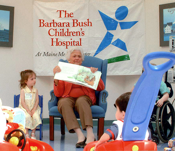 Barbara Bush reading to a group of young children at the BBCH