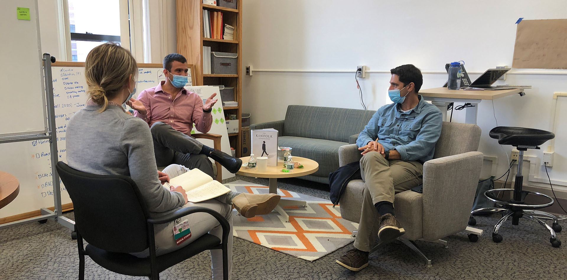 a group of researchers having a discussion